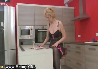 blonde older wife in dark stockings