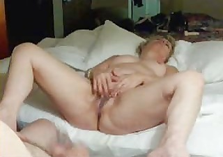 mature lady fingering her muff !